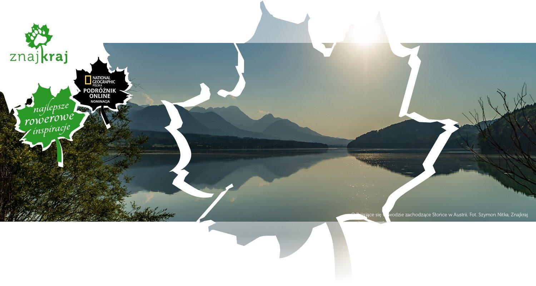 Odbijające się w wodzie zachodzące Słońce w Austrii