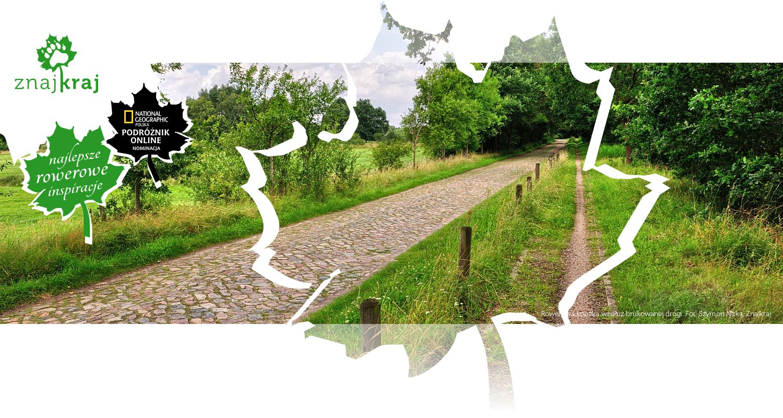 Rowerowa ścieżka wzdłuż brukowanej drogi